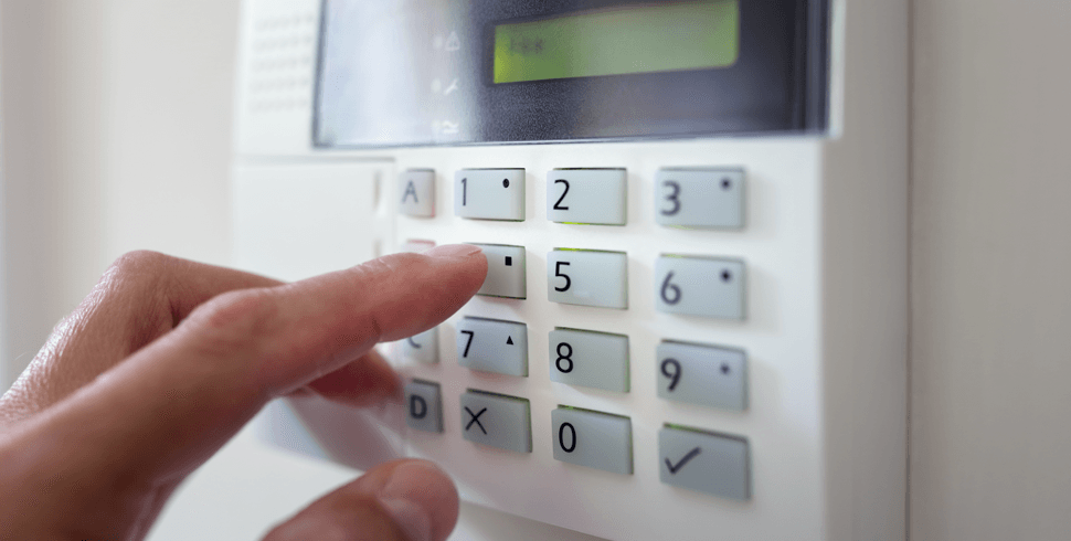 Person turning on alarm system