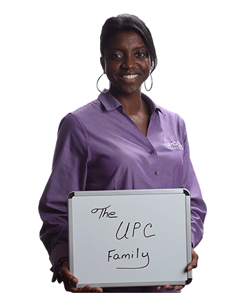 Brigette Broxton holding a sign which reads 'The UPC Family'